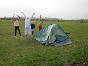 Polar children celebrate putting up tent